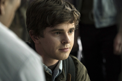 "In this image released by ABC, Freddie Highmore portrays Shaun Murphy in a scene from ""The Good Doctor."" Highmore stars as a young surgeon with autism who joins a prestigious hospital's surgical unit. The Nielsen company said last week's episode airing Monday night was the most popular show on ABC. (Liane Hentscher/ABC via AP)"