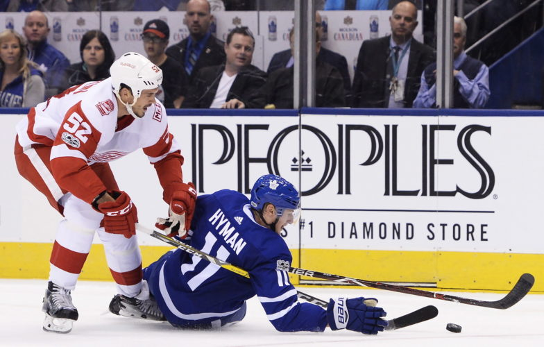 Detroit Red Wings defenseman Jonathan Ericsson (52) trips Toronto Maple Leafs center Zach Hyman (11) during the second period of a game on Wednesday in Toronto. (AP)