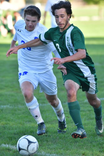 South Williamsport's Caleb Snyder (31) and Leighow (22) battle for control of the ball during the first half.   (MARK NANCE/Sun-Gazette)
