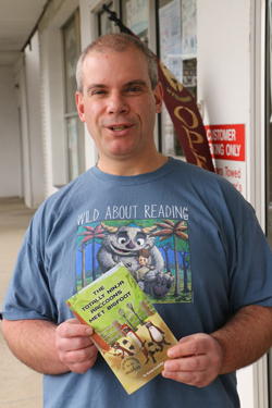 """PHOTO PROVIDED Kevin Coolidge, owner of From My Shelf Books and author of the """"Totally Ninja Raccoons"""" children's series. Both are nominees for the indie Small Business Award."""