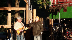 PHOTO PROVIDED Logan Roush gets ready to address the crowd while JR Keister adds some music at the recent Mike & Dot's II reunion event.