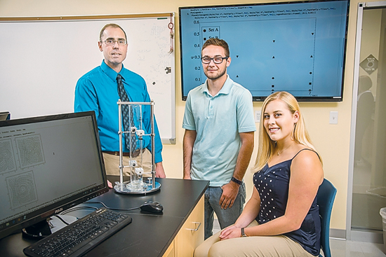 PHOTO PROVIDED Lycoming College physics majors Brianna Zawadzki and Tom Osborne, and Dr. Christopher Kulp, professor of physics and chair of the department of astronomy and physics at Lycoming College, recently co-authored a paper published in prominent academic journal The Physical Review E, in August.