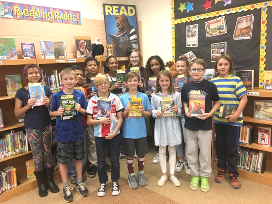 PHOTO PROVIDED The Williamsport Area School District Education Foundation (WASDEF) has awarded 95 kindergarten to sixth-grade students who completed the James V. Brown Library's 2017 Summer Reading Program with brand-new books in their honor.