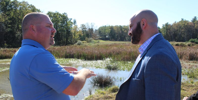 CARA MORNINGSTAR/Sun-Gazette Jonathan Klotz, president of Natural Waterscapes, left, speaks to Ramez Ziadeh, Department of Environmental Protection deputy secretary, right, during a tour of the pond and the new wetland area at Camp Victory in Millville. Representatives from the Department of Environmental Protection came out to celebrate the finish wetland construction project to provide a recreational and education area to children with special needs.