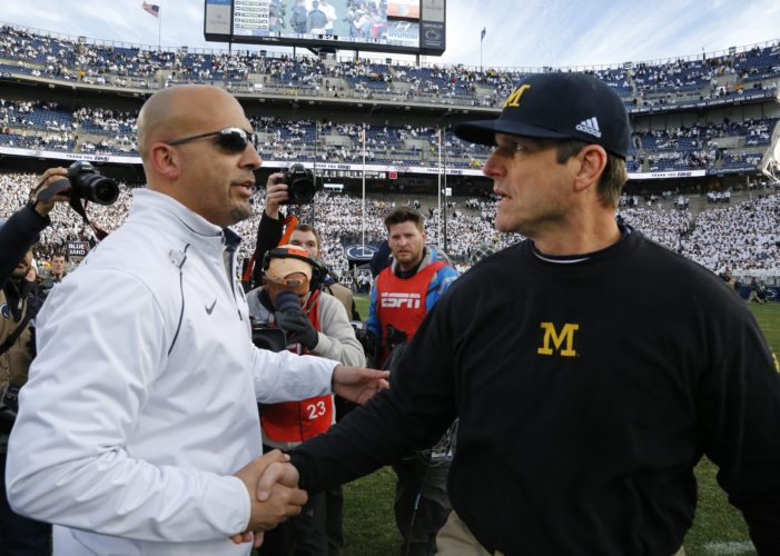 Michigan head coach Jim Harbaugh, right shakes hands with Penn State head coach James Franklin after an NCAA college football game in State College, Pa., Saturday, Nov. 21, 2015. Michigan won 28-16. (AP Photo/Gene J. Puskar)