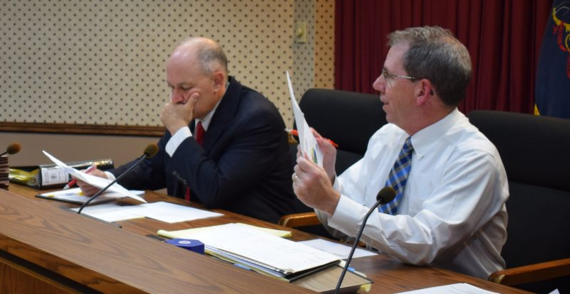IOANNIS PASHAKIS/Sun-Gazette Lycoming County commissioners Rick Mirabito, above left, and Jack McKernan, above right, share details of the 2017-18 county budget with an audience Monday night.
