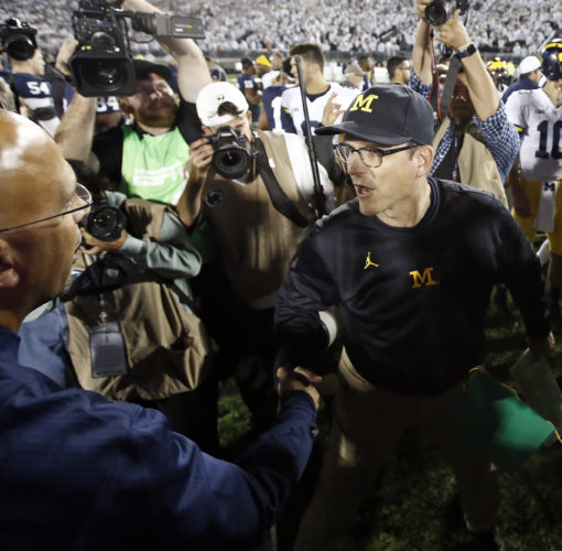 ASSOCIATED PRESS Jim Harbaugh and Michigan are 5-2 after losing at Penn State.
