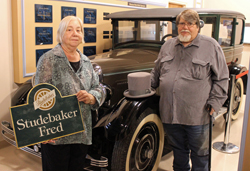 PHOTO PROVIDED Pat and Jim Messner stand in front of the 1926 Studebaker that they recently donated to the Taber Museum.