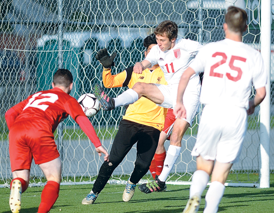 RALPH WILSON/Sun-Gazette Correspondent Williamsport's Tiarnan Ferry (11) scores early in the the first half of a District 2-4 Class AAAA semifinal soccer game against Hazleton on Wednesday at the Balls Mills Soccer Club.