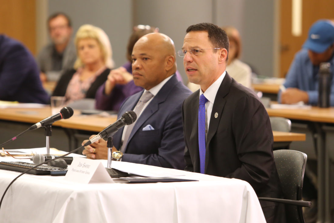 "KAREN VIBERT-KENNEDY/Sun-Gazette Josh Shapiro, state attorney general, right, speaks to The Center for Rural Pennsylvania board members during a public hearing on the ""State of Addiction"" Thursday at UPMC Susquehanna Regional Medical Center. Seated to the left of Shapiro is Gary Tuggle, special agent in charge, US Drug Enforcement Administration."