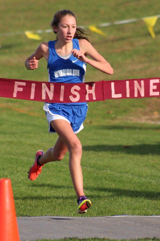 CARAMORNINGSTAR/Sun-Gazette Lauren Trapani of Warrior Run wins the girls Class Arace Thursday at Bloomsburg.