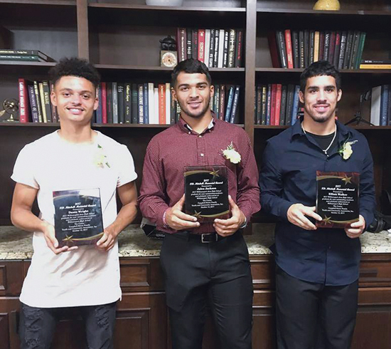 PHOTO PROVIDED Shown, from left, are P.D. Mitchell Memorial Award Recipients Dante Wright, Jalen Jackson and Elliott Walker