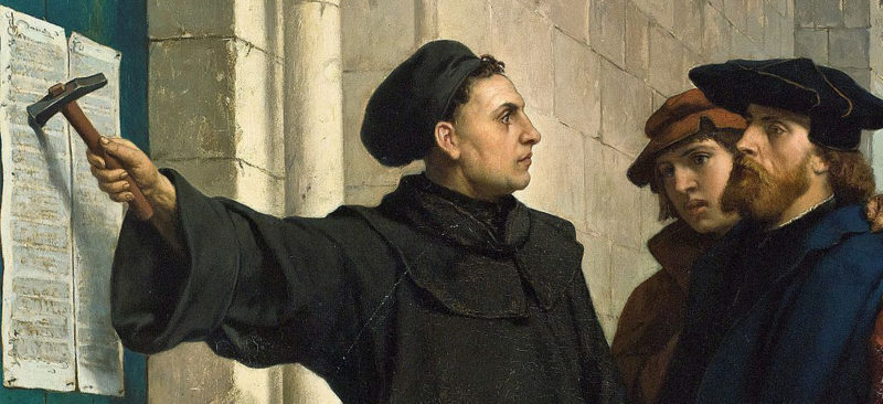 A painting shows Martin Luther nailing his 95 Theses to the door of Wittenberg Church in Germany in 1517.