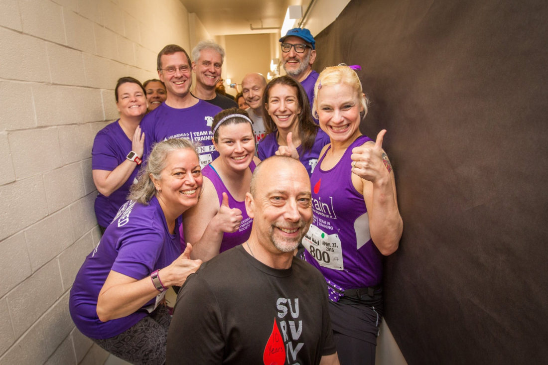 PHOTO PROVIDED Ronald Frick, second from the left in the third row, stands with a group of his teammates from Team in Training, part of the Leukemia and Lymphoma Society that participates in charitable races to raise money for blood cancer research.