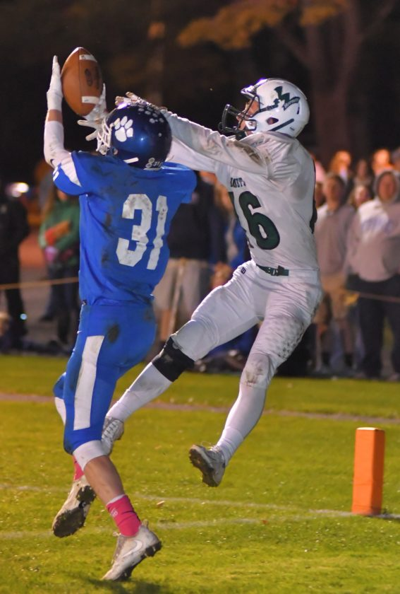 MARK NANCE/Sun-Gazette NP-Mansfield's Dylan Wesneski (31) breaks up a pass intended for Wellsboro's Tyler Wright (16) in the second quarter Friday at NP-Mansfield.