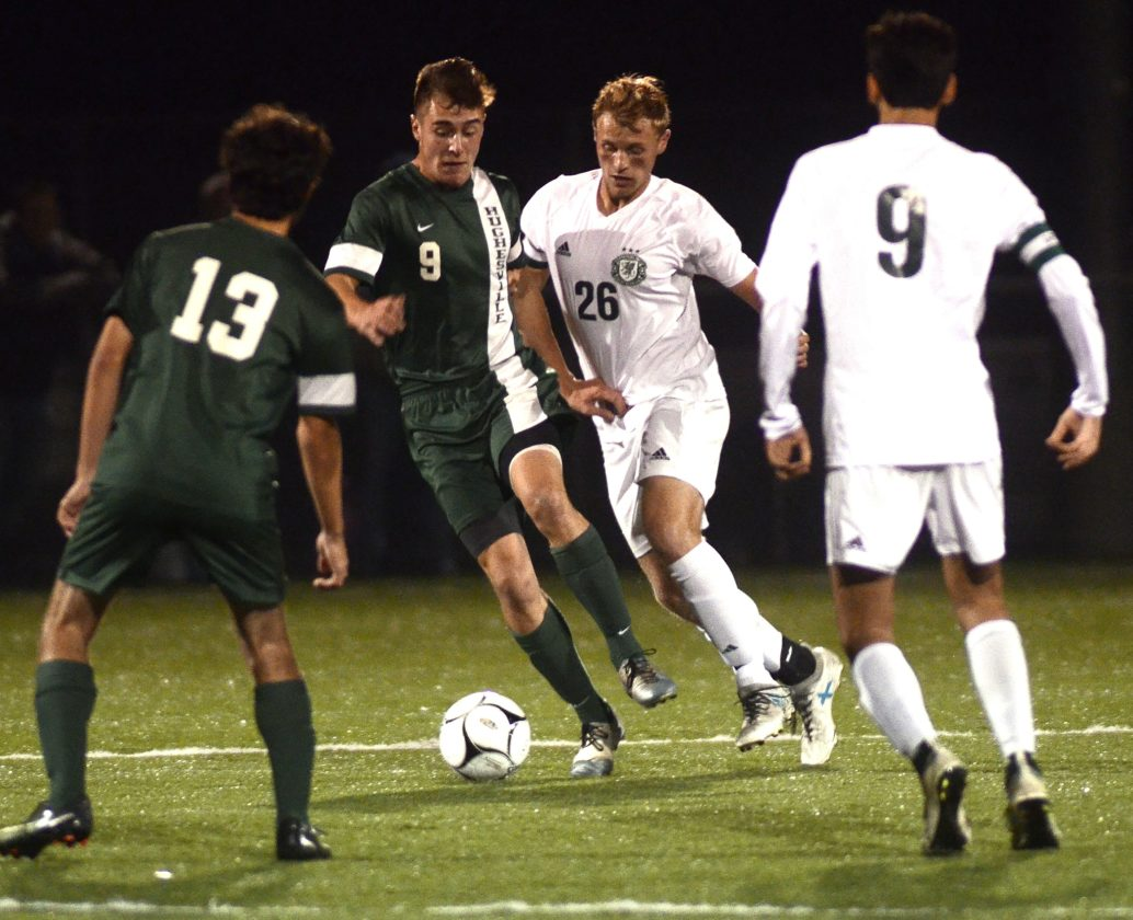 RALPH WILSON/Sun-Gazette Correspondent Hughesville's Nick Sharayko (9) and Lewisburg's Nate Liscom (26) battle for possession of the ball duing the first half on Saturday at Balls Mills.