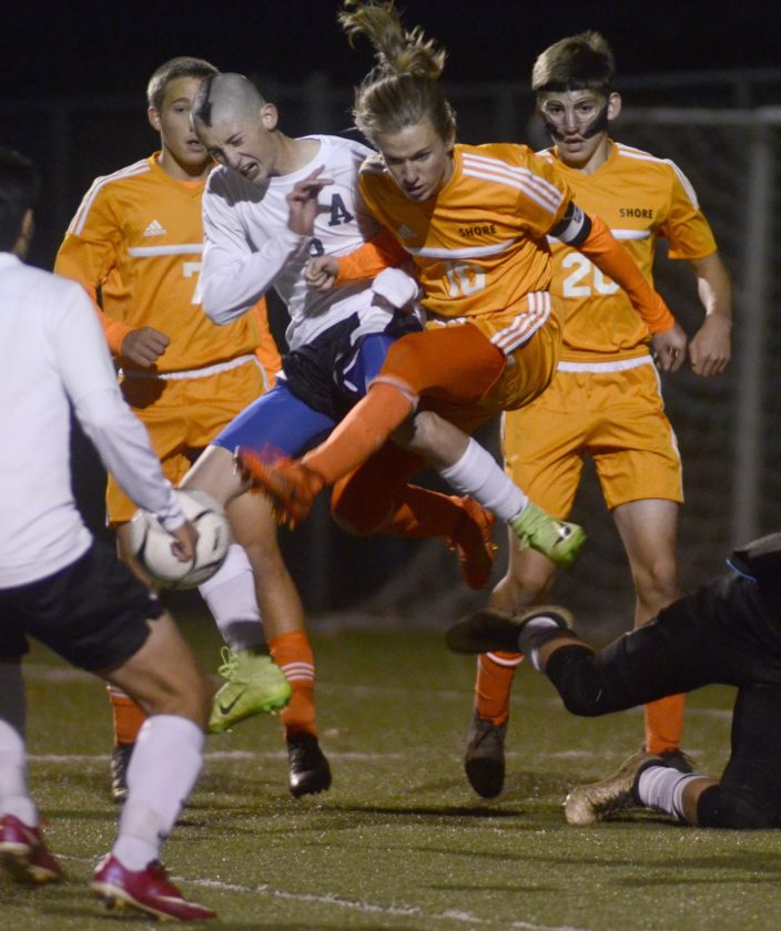 RALPH WILSON/Sun-Gazette Correspondent Athens' Aaron Lane (3) and Jersey Shore's Mason Zondory (10) struggle for control Monday at Balls Mills in the District 4 Class AAA boys soccer playoffs.