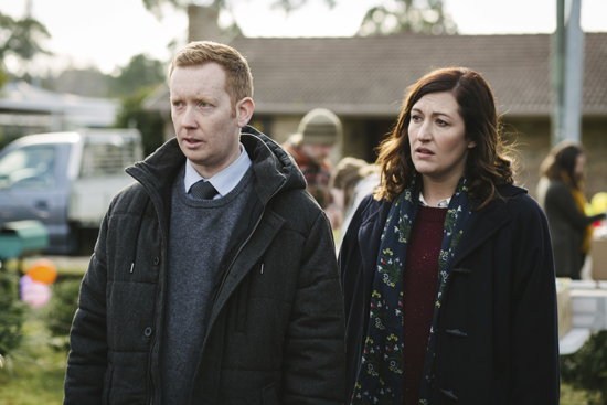 "This image released by SundanceTV shows Celia Pacquola, right, and Luke McGregor in a scene from ""Rosehaven."" The series is set in Australia, where McGregor's character returns to his rural hometown to run his ailing mother's real-estate business. Meanwhile, Pacquola's character lands on his doorstep after her marriage goes bust.  (Scott Bradshaw/SundanceTV via AP)"