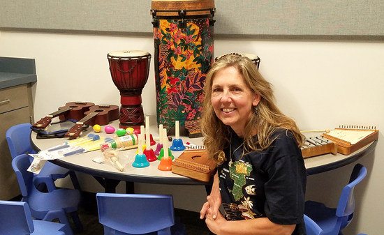 PHOTO PROVIDED Aegina Leidhecker sits with musical instruments for her classes for the Uptown Music Collective's new early music education program, Discovering Music. The Collective will host an open house 11 a.m. Saturday. For more information, visit www.uptown music.org/discoveringmusic.