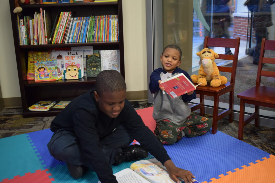 IOANNIS PASHAKIS/Sun-Gazette Tajer King, left, and Camden King, right, are the first kids to enjoy River Valley Health and Dental Center's new book nook that it dedicated Wednesday night.