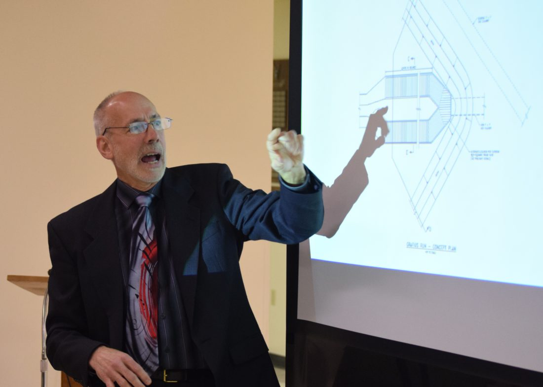 IOANNIS PASHAKIS/Sun-Gazette Jeri McClune, chief engineer for water resources, talks to local homeowners and county officials about the preliminary concepts for the Grafius Run flood mitigation project.
