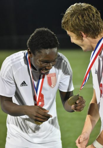 MARK NANCE/Sun-Gazette Williamsport's Tom Pombor (9) and Leo Daverio (8) admire each other's district championship medals after beating Delaware Valley at Balls Mills Thursday.