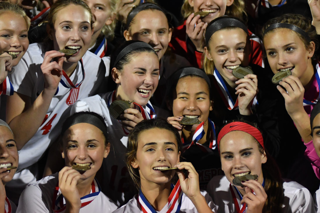 MARK NANCE/Sun-Gazette Williamsport girls soccer players pose with their medals after beating Delaware Valley for the district championship Thursday at Balls Mills.