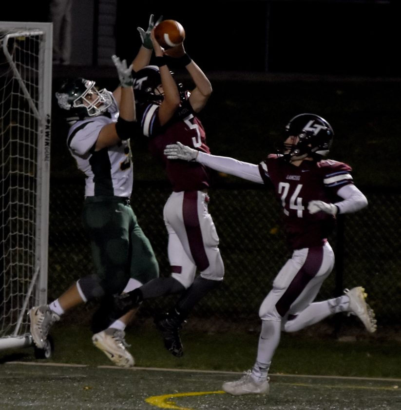 JUDI PINKERTON/For The Sun-Gazettt Jacob Waltz of Loyalsock breaks up a pass to Lewisburg's Dakoth Snyder, Friday night