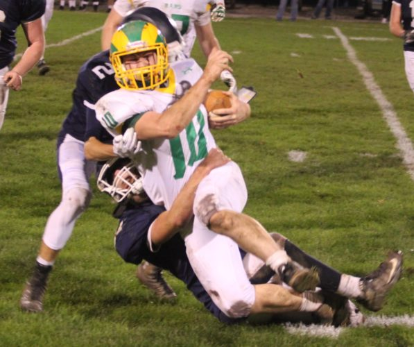 CHRIS DOWNS/For The Sun-Gazette Wyalusing running back Creighton Edsell (10) is taken to the ground by Muncy's Michael Kustanbauter (27) and Dylan Wilt (2) during the first half Friday night at Muncy.