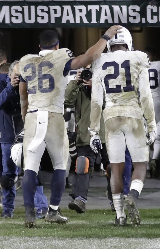 ASSOCIATED PRESS Penn State running back Saquon Barkley (26) and cornerback Amani Oruwariye (21) walk out of Spartan Stadium after Saturday's loss in East Lansing, Mich.