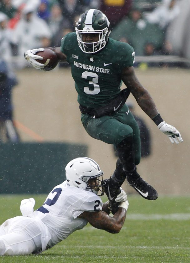 ASSOCIATED PRESS Michigan State's LJ Scott (3) slips away from a tackle attempt by Penn State's Marcus Allen (2) during the third quarter Saturday.