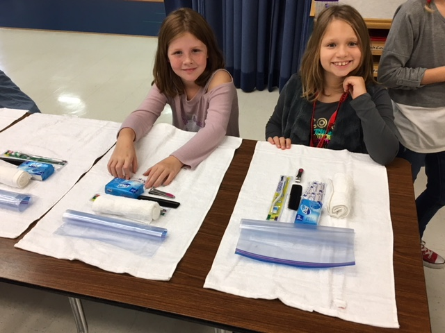 PHOTO PROVIDED Williamsport Area School District's Cochran Primary School students help put together hygiene packs and cleaning supplies at Cochran Primary School recently in order to help those in need due to hurricane disasters.