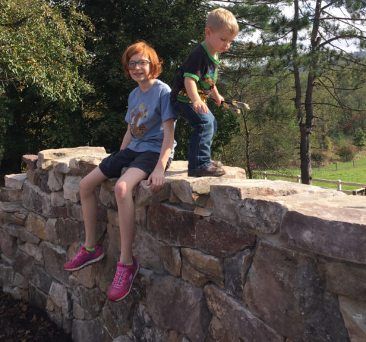 PHOTO PROVIDED  Lily, 11, and Braxton Waltz, 2 1/2, check out the new rock wall in the Lycoming County Master Gardeners' Sensory Garden at the Lysock View Complex in Loyalsock Township.