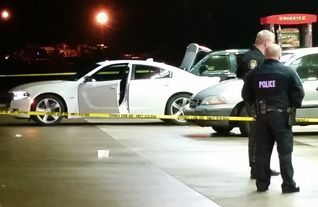 PHILIP A. HOLMES/Sun-Gazette A witness said the driver of this white Dodge Charger pulled into Sheetz on Route 220 Tuesday night and exchanged gunfire with state troopers who were pursuing him. The driver died, but it was unclear if it was the result of a self-inflicted gunshot wound or from gunfire from police.