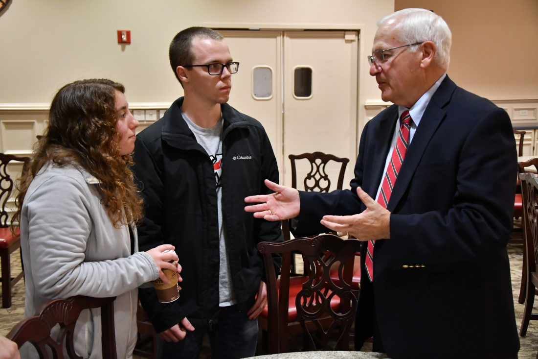 MARK NANCE/Sun-Gazette Lycoming College junior Alexandra Rozzi, of Stroudsburg, and senior Jacob Quasius, of Byram, New Jersey, speak with state Sen. Gene Yaw, R-Loyalsock Township, during his visit to the Energy and the Future series at Lycoming College Wednesday.