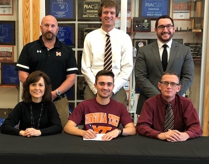 SUBMITTED PHOTO Tyler Leeser of Milton signed a letter-of-intent this week to the track team at Virginia Tech. In front with Tyler are parents Janice and Tom, also his head coach. In back are Milton athletic director Rod Harris, coach Johnathan Dick, and principal Andrew Rantz.