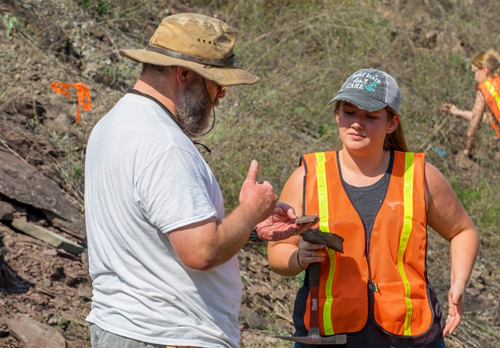 PHOTO PROVIDED Broussard points out fossils to Darby Willingham, '19, while Cali Snyder, '19, digs in the background during a recent Natural History of Dinosaurs class field trip.