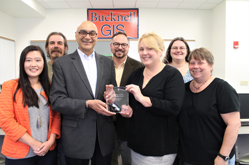PHOTO PROVIDED Members of Bucknell University's Digital Pedagogy and Scholarship team display the Special Achievement in GIS (geographic information systems) Award (SAG Award) it received from Esri, the global leader in spatial analytics. Shown, front row from left, are members of the team including Luyang Ren, GIS/web application specialist; Param Bedi, vice president for library and information technology; Janine Glathar, digital pedagogy and scholarship specialist for GIS; and Lorraine Eisenhuth, systems integrator. And back row, from left, are Todd Fogle, senior technology support specialist; Matt Gardzina, director of digital pedagogy and scholarship; and Carrie Pirmann, social sciences librarian.