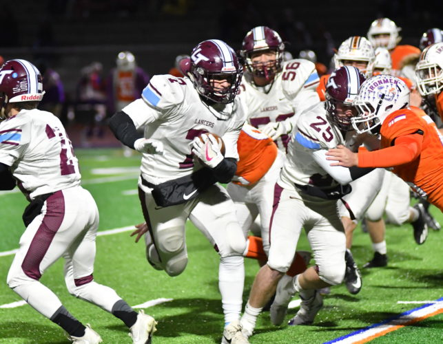 Loyalsock's Hunter Webb runs with the ball against Danville on Friday night at Danville High School during the District 4 Class AAA championship game. The Lancers won, 35-6. (MARK NANCE/Sun-Gazette)