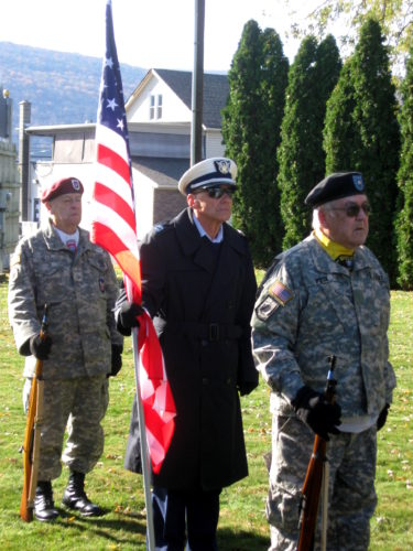 D. EVERETT SMITH/Sun-Gazette Correspondent  From left, PFC Don Hills, Lt. Terry Banfill, and Sgt. William Peck, of the Lock Haven Color Guard, are ready to present colors at Montoursville's ceremony Saturday.