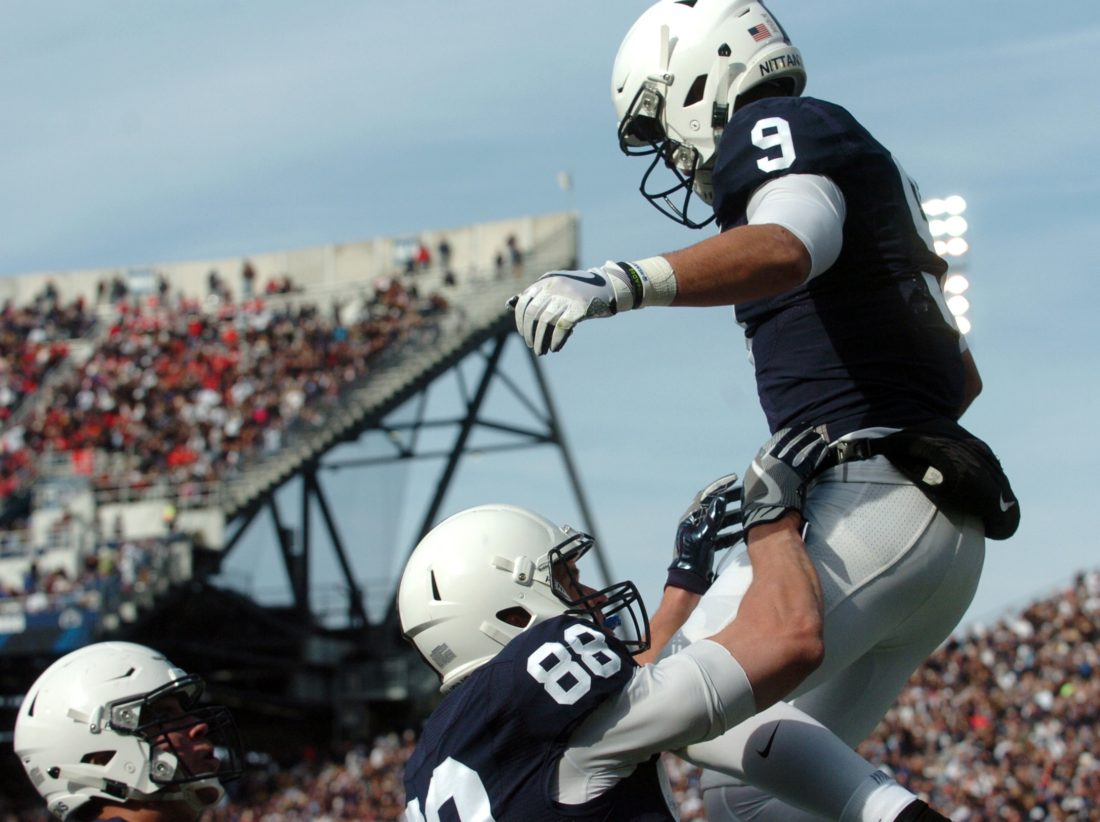PATRICK WAKSMUNSKI/For The Sun-Gazette Trace McSorley celebrates his 20-yard touchdown run with Mike Gesicki.