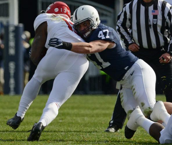PATRICK WAKSMUNSKI/For The Sun-Gazette Penn State linebacker Brandon Smith tackles Rutgers' Gus Edwards Saturday at Beaver Stadium.