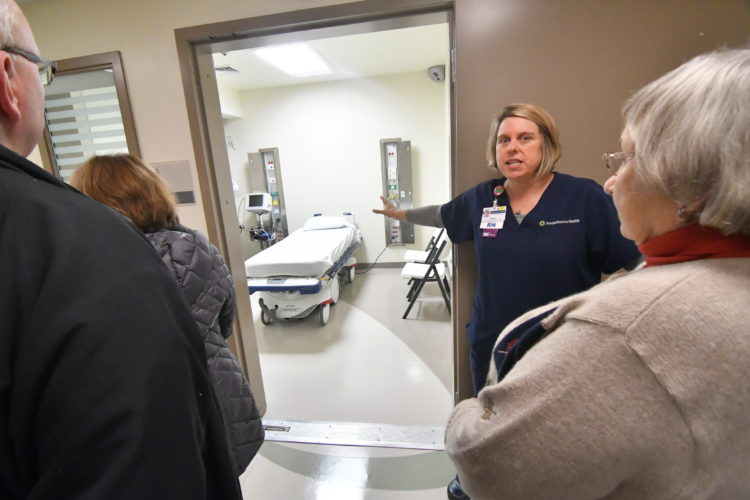MARK NANCE/Sun-Gazette Denise Parke, UPMCSusquehanna Muncy Valley Hospital emergency room educator, middle, shows off the secure room during an open house of the expanded and renovated hospital emergency room on Monday.