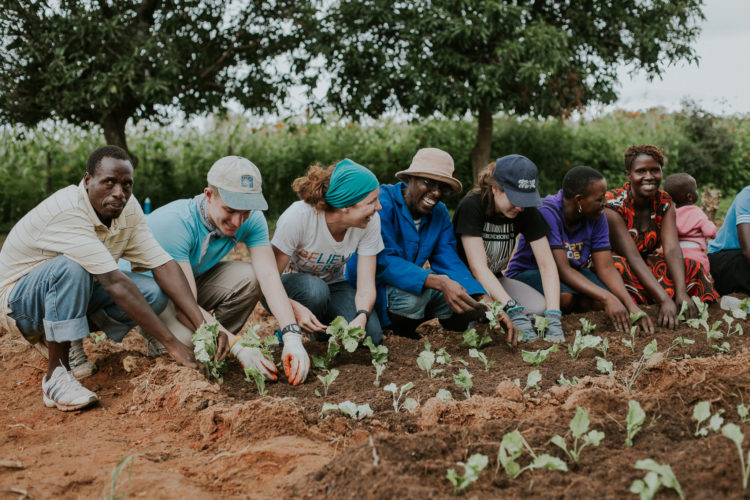 PHOTOS PROVIDED  Members of 2 Seconds or Less and residents of Zimbabwe work to plant a sustainable garden to help feed locals.