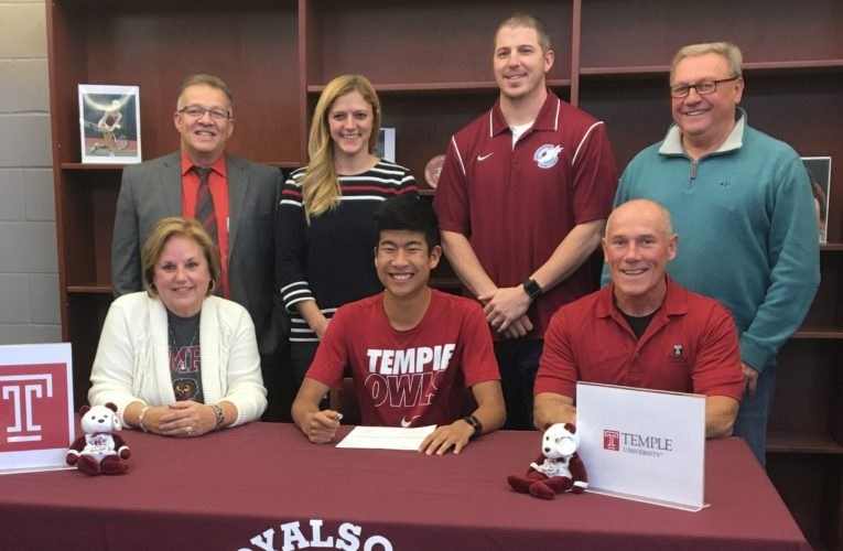 SUBMITTED PHOTO Quinn Serfass signed his letter-of-intent this month to continue his track and cross country career at Temple. Seated with Serfass are parents Beth and Shaun. In back are Loyalsock superintendent Jerry McLaughlin, asisstant principal Ashley Sekel, track coach Matt Hill, and athletic director Ron Insinger.