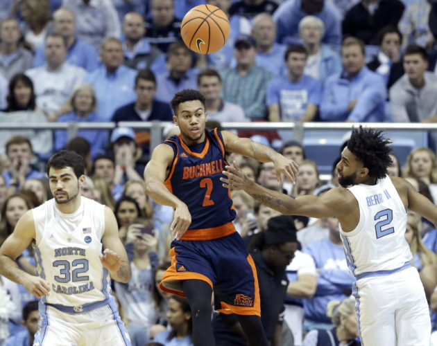 North Carolina's Luke Maye (32) and Joel Berry II (2) guard Bucknell's Stephen Brown (2) during the first half of an NCAA college basketball game in Chapel Hill, N.C., Wednesday, Nov. 15, 2017. (AP Photo/Gerry Broome)