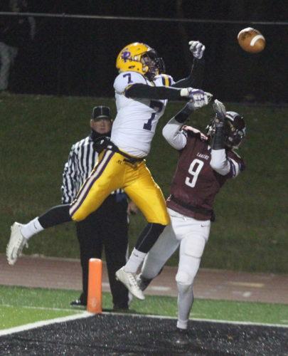 Scranton Prep's Luke Johnson breaks up a pass intended for Loyalsock's Gerald Ross during a playoff game Friday at Williamsport High School. (KAREN VIBERT-KENNEDY/Sun-Gazette)