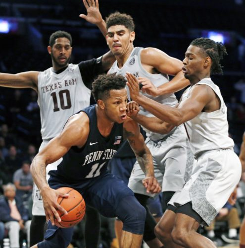 ASSOCIATED PRESSa Texas A&M center Tonny Trocha-Morelos (10) and teammates, right, defend Penn State forward Lamar Stevens (11), who tries to get out of heavy traffic during the second half Tuesday in Brooklyn.