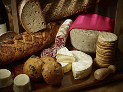 This Nov. 3, 2017 photo provided by The Culinary Institute of America shows a charcuterie box in Hyde Park, N.Y. Edible gifts are always a huge hit, especially at busy times of the year. (Phil Mansfield/The Culinary Institute of America via AP)