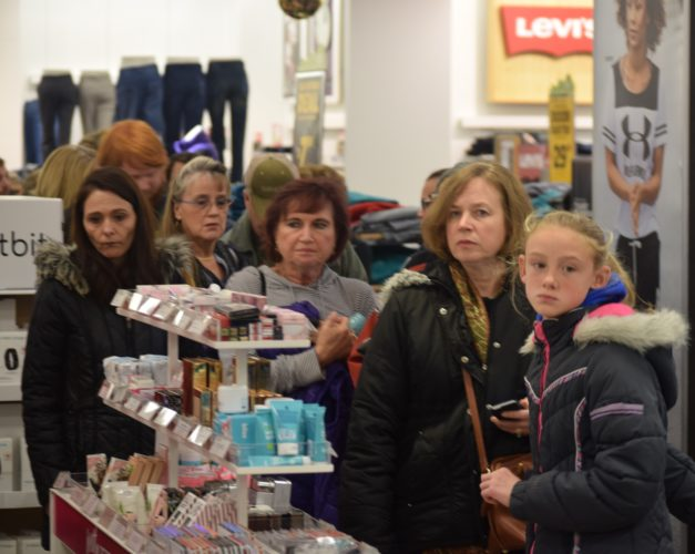 "IOANNIS PASHAKIS/ Sun-Gazette Customers flocked to the Kohl's in Williamsport on Thanksgiving night to get a start on Black Friday deals and to get their hands on early ""Door Busters."""